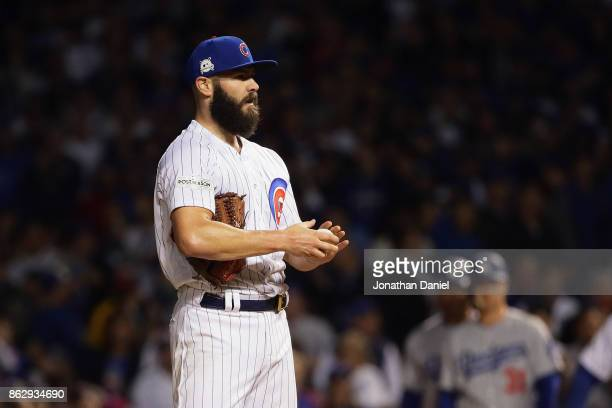 Jake Arrieta of the Chicago Cubs stands on the mound in the seventh inning against the Los Angeles Dodgers during game four of the National League...