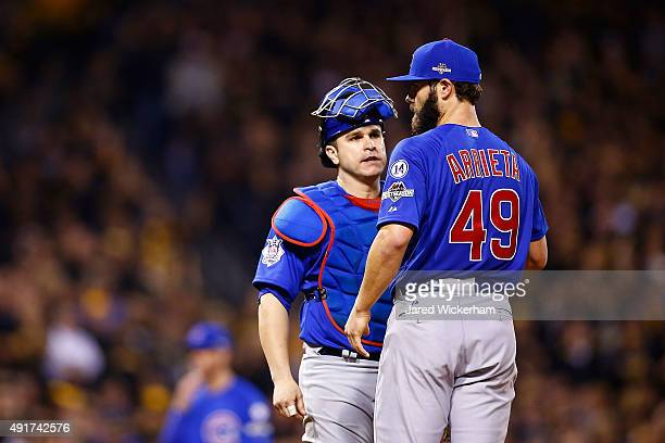 Jake Arrieta of the Chicago Cubs talks with Miguel Montero of the Chicago Cubs on the pitcher's mound in the sixth inning during the National League...