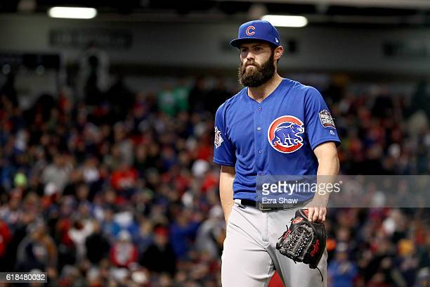 Jake Arrieta of the Chicago Cubs walks back to the dugout after being relieved during the sixth inning against the Cleveland Indians in Game Two of...