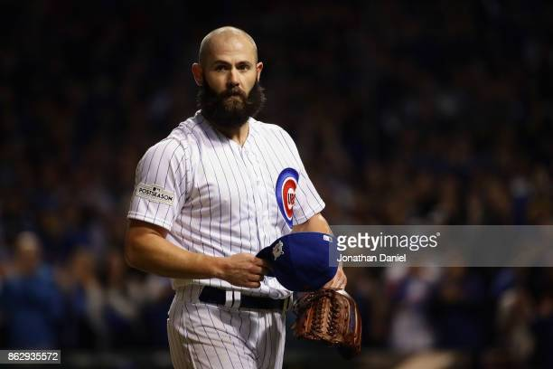 Jake Arrieta of the Chicago Cubs walks off the field after being relieved in the seventh inning against the Los Angeles Dodgers during game four of...