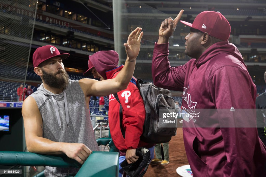 Jake Arrieta #49 of the Philadelphia Phillies high fives Hector Neris #50 after the game against the Pittsburgh Pirates at Citizens Bank Park on April 19, 2018 in Philadelphia, Pennsylvania. The Phillies defeated the Pirates 7-0.