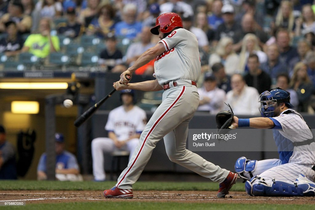 Jake Arrieta #49 of the Philadelphia Phillies hits a single in the third inning against the Milwaukee Brewers at Miller Park on June 15, 2018 in Milwaukee, Wisconsin.