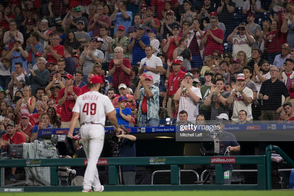 Jake Arrieta #49 of the Philadelphia Phillies receives a standing ovation from the fans as he makes his way to the dugout after being taken out of the game in the top of the seventh inning against the Atlanta Braves at Citizens Bank Park on May 23, 2018 in Philadelphia, Pennsylvania. The Phillies defeated the Braves 4-0.
