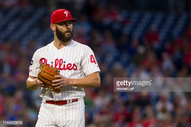 Jake Arrieta of the Philadelphia Phillies walks to the dugout after the end of the top of the third inning against the Milwaukee Brewers at Citizens...