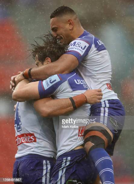 Jake Averillo of the Bulldogs celebrates his try with team mates during the round 11 NRL match between the Newcastle Knights and the Canterbury...