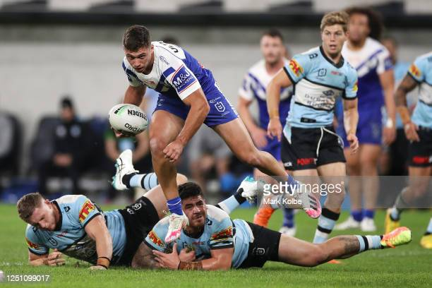 Jake Averillo of the Bulldogs jumps out of the tackle during the round six NRL match between the Cronulla Sharks and the Canterbury Bulldogs at...