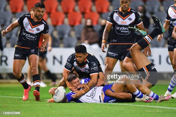 Jake Averillo of the Bulldogs scores a try during the round 25 NRL match between the Wests Tigers and the Canterbury Bulldogs at Moreton Daily...