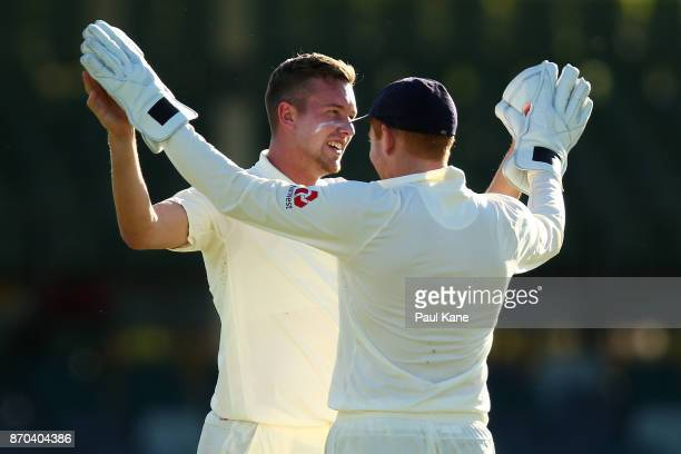 Jake Ball and Jonny Bairstow of England celebrate of Calum How of the WA XI during day two of the Ashes series Tour Match between Western Australia...
