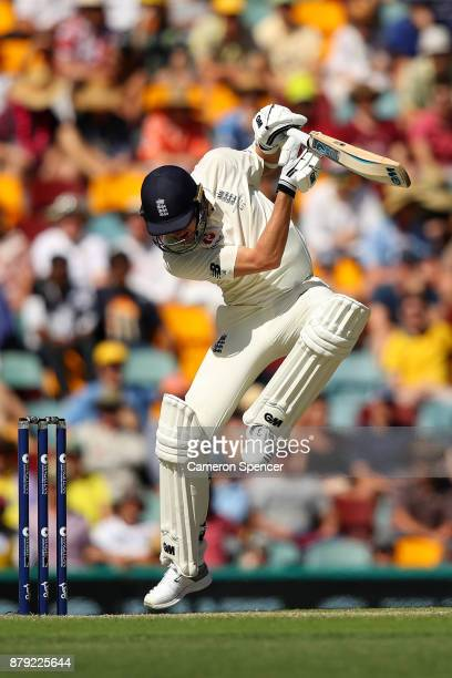 Jake Ball of England avoids a delivery by Pat Cummins of Australia during day four of the First Test Match of the 2017/18 Ashes Series between...