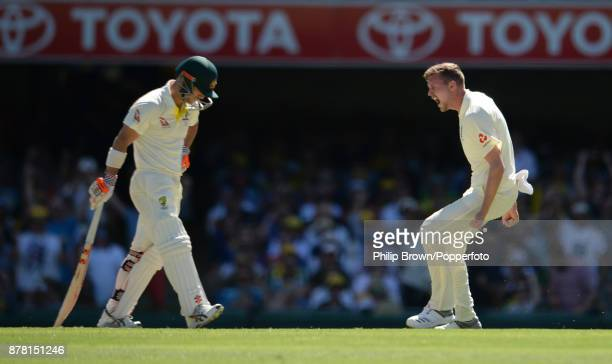 Jake Ball of England celebrates after having David Warner of Australia caught on the second day of the first Ashes cricket test match between...