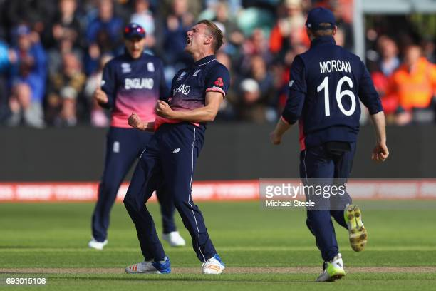 Jake Ball of England celebrates capturing the wicket of Ross Taylor of New Zealand during the ICC Champions Trophy match between England and New...