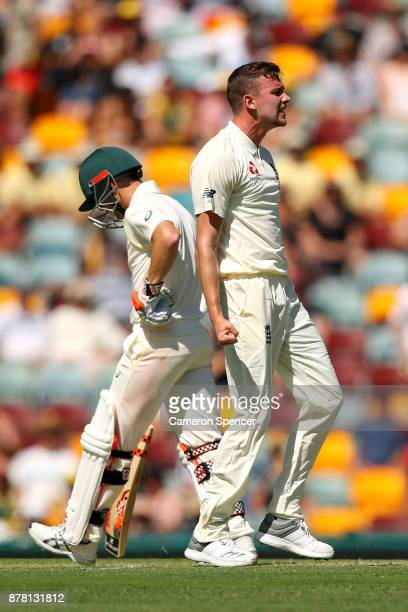 Jake Ball of England celebrates dismissing David Warner of Australia during day two of the First Test Match of the 2017/18 Ashes Series between...