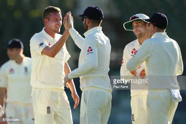 Jake Ball of England celebrates the wicket of Calum How of the WA XI during day two of the Ashes series Tour Match between Western Australia XI and...