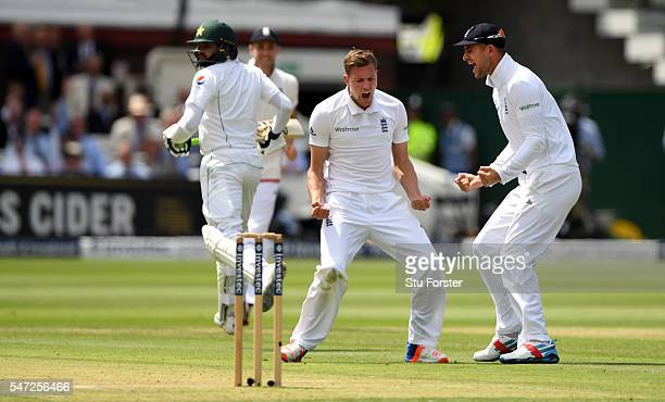 Jake Ball of England celebrates with Alex Hales after taking his first test wicket that of Pakistan batsman Azhar Ali during day one of the 1st...