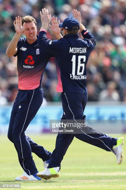 Jake Ball of England celebrates with captain Eoin Morgan after capturing the wicket of Andrew Balbirnie of Ireland during the Royal London One Day...