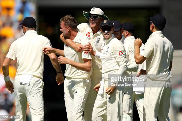 Jake Ball of England celebrates with team mates after dismissing David Warner of Australia during day two of the First Test Match of the 2017/18...
