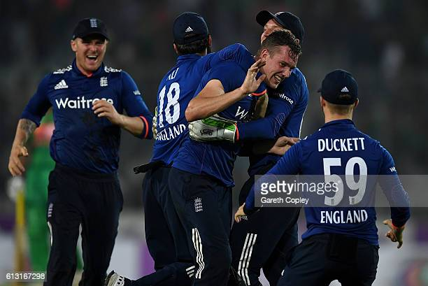 Jake Ball of England celebrates with teammates after taking the final wicket of Taskin Ahmed of Bangladesh to win the 1st One Day International match...