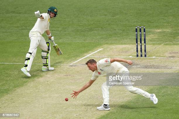 Jake Ball of England fields his own delivery during day three of the First Test Match of the 2017/18 Ashes Series between Australia and England at...