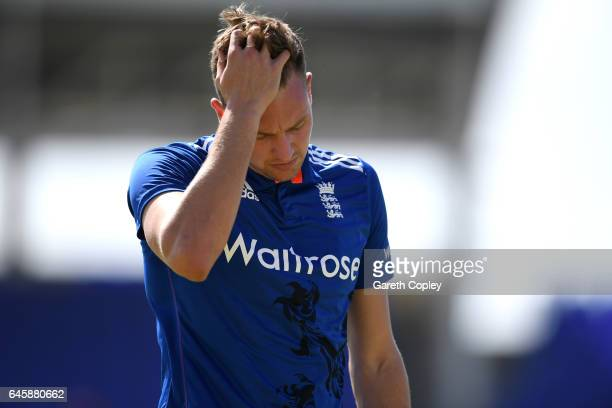 Jake Ball of England leaves the field after picking up an injury while bowling during the tour match between WICB President's XI and England at...