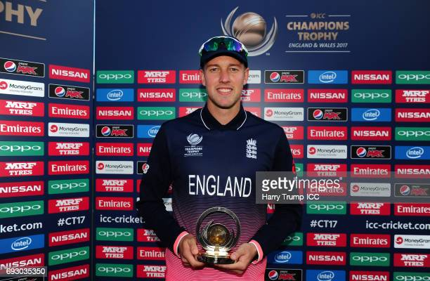 Jake Ball of England poses with the man of the match award during the ICC Champions Trophy match between England and New Zealand at SWALEC Stadium on...