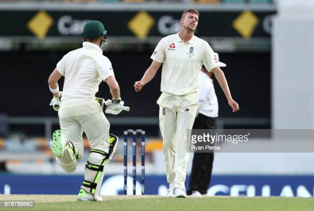 Jake Ball of England reacts while bowling during day three of the First Test Match of the 2017/18 Ashes Series between Australia and England at The...