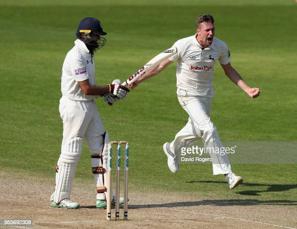 Jake Ball of Nottinghamshire celebrates after taking the match winning wicket of Hashim Amla during day four of the Specsavers County Championship...