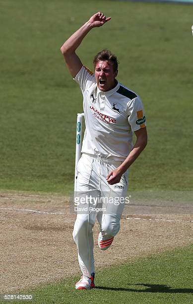 Jake Ball of Nottinghamshire celebrates after taking the wicket of Adam Lyth during the Specsavers County Championship division one match between...