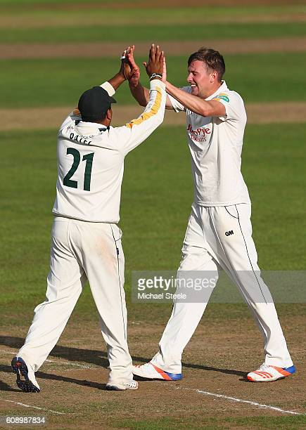 Jake Ball of Nottinghamshire celebrates taking the wicket of Peter Trego with Samit Patel during day one of the Specsavers County Championship...