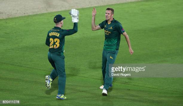 Jake Ball of Nottinghamshire celebrates with team mate Tom Moores after combining to take the wicket of Alex Hughes during the NatWest T20 Blast...