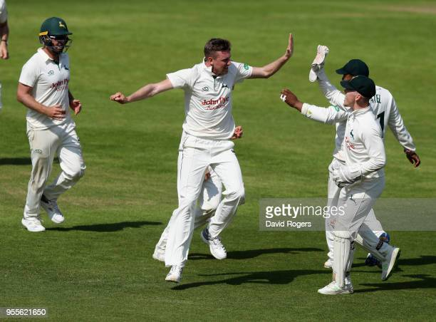 Jake Ball of Nottinghamshire celebrates with team mates after taking the wicket of Kyle Abbott during day four of the Specsavers County Championship...