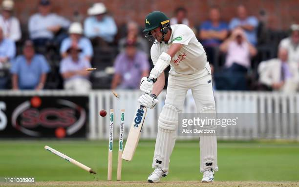 Jake Ball of Nottinghamshire is bowled by Jamie Overton of Somerset to win the game during Day Three of the Specsavers County Championship Division...