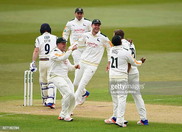 Jake Ball of Nottinghamshire is congratulated by Steven Mullaney and Stuart Broad on the wicket of Adam Lyth of Yorkshire during the Specsavers...