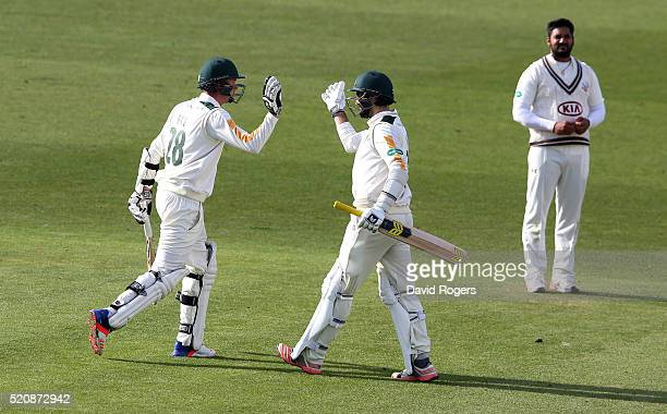 Jake Ball of Nottinghamshire who scored the winning runs celebrates with team mate Brett Hutton during the Specsavers County Championship division...