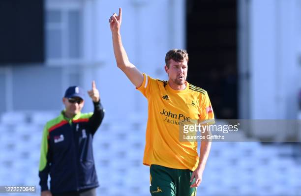 Jake Ball of Notts Outlaws celebrates the wicket of Matthew Critchley of Derbyshire Falcons hits out to the boundary during the T20 Vitality Blast...