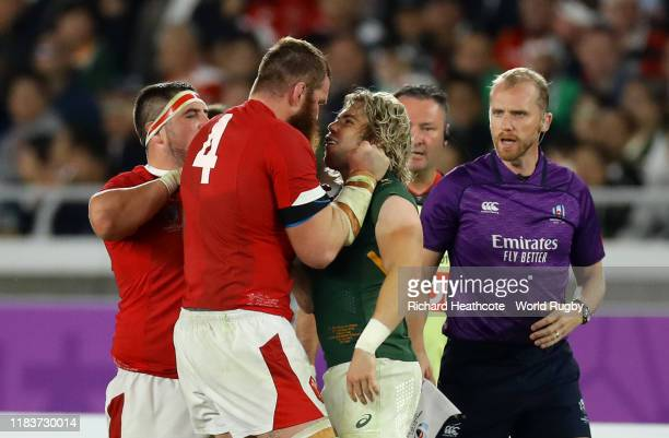 Jake Ball of Wales clashes with Faf de Klerk of South Africa during the Rugby World Cup 2019 SemiFinal match between Wales and South Africa at...