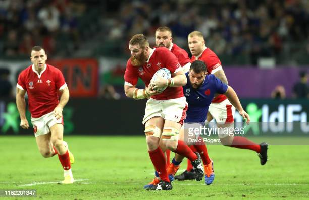 Jake Ball of Wales is tackled by Rabah Slimani of France during the Rugby World Cup 2019 Quarter Final match between Wales and France at Oita Stadium...