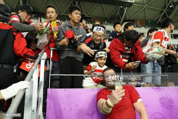 Jake Ball of Wales poses for a selfie with fans after the Rugby World Cup 2019 Quarter Final match between Wales and France at Oita Stadium on...