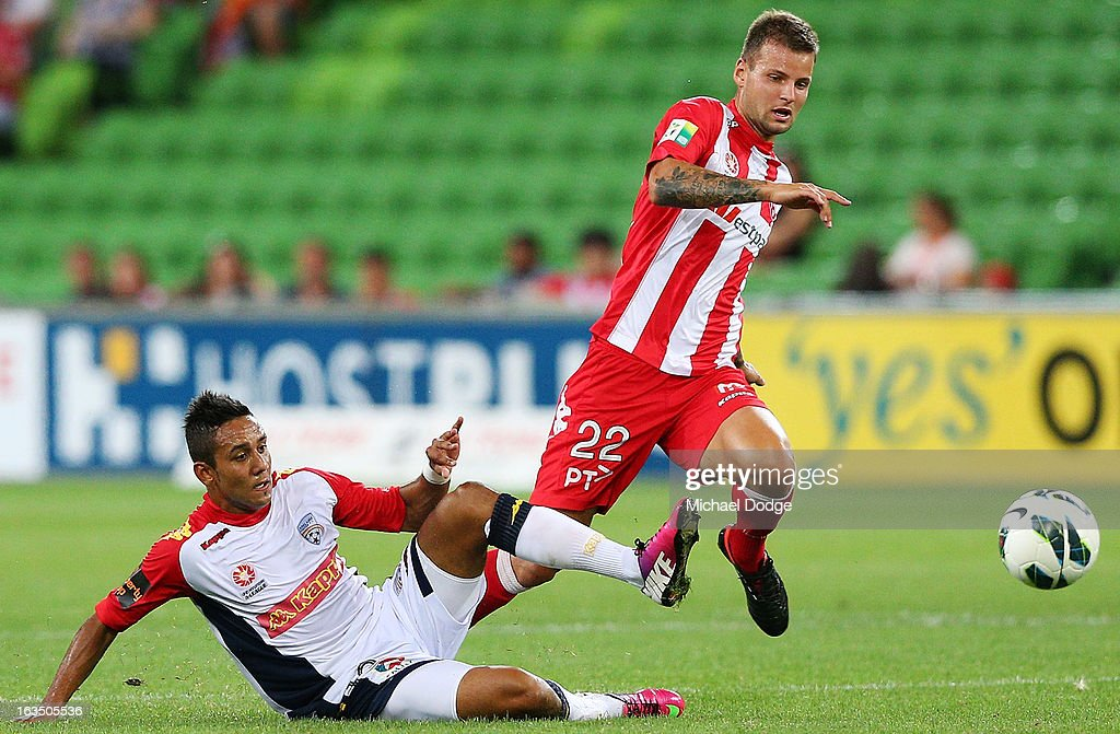 Jake Barber-Daish (L) of Adelaide United contests for the ball against Nick Kalmar of the Heart during the round 24 A-League match between the Melbourne Heart and Adelaide United at AAMI Park on March 11, 2013 in Melbourne, Australia.