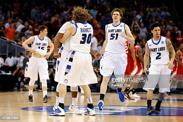 Jake Barnett of the Saint Louis Billikens celebrates with teammate Jordair Jett after defeating the North Carolina State Wolfpack in overtime during...