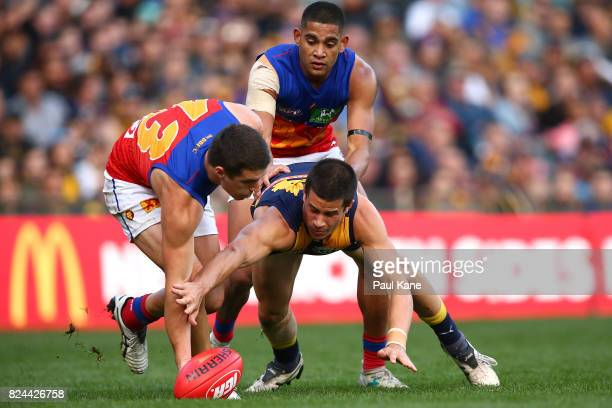 Jake Barrett of Lions and Liam Duggan of the Eagles contest for the ball during the round 19 AFL match between the West Coast Eagles and the Brisbane...