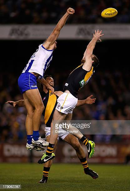 Jake Batchelor of the Tigers attempts to mark the ball during the round 15 AFL match between the North Melbourne Kangaroos and the Richmond Tigers at...