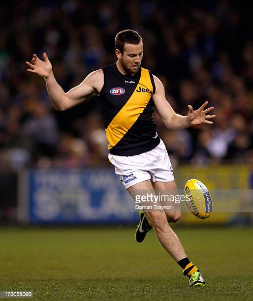Jake Batchelor of the Tigers kicks the ball during the round 15 AFL match between the North Melbourne Kangaroos and the Richmond Tigers at Etihad...