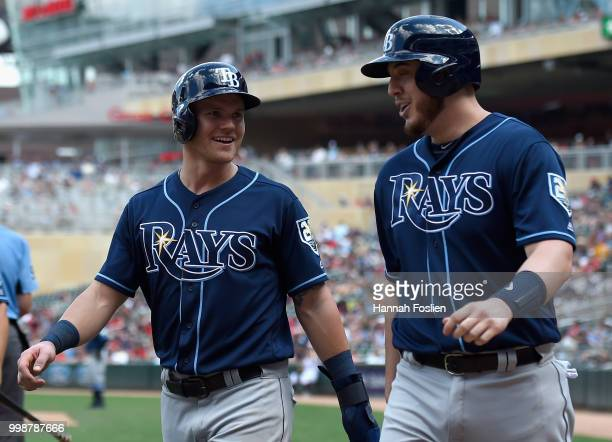 Jake Bauers and CJ Cron of the Tampa Bay Rays celebrate scoring against the Minnesota Twins during the seventh inning of the game on July 14 2018 at...