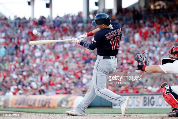 Jake Bauers of the Cleveland Indians hits a single to right field to drive in two runs in the ninth inning against the Cincinnati Reds at Great...