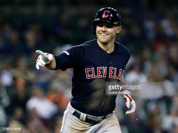 Jake Bauers of the Cleveland Indians points to his dugout after hitting a two-run home run to complete the cycle against the Detroit Tigers during...