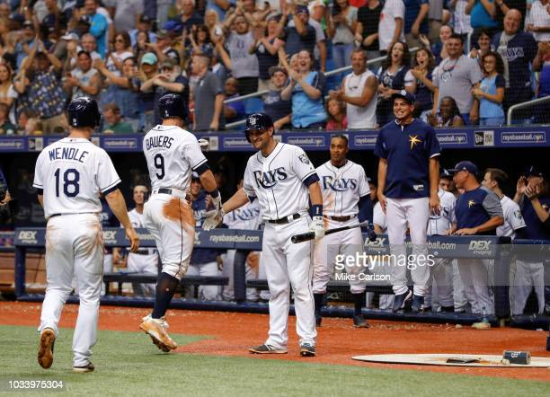 Jake Bauers of the Tampa Bay Rays celebrates with Nick Ciuffo and Joey Wendle after his threerun home run in the eighth inning of a baseball game...