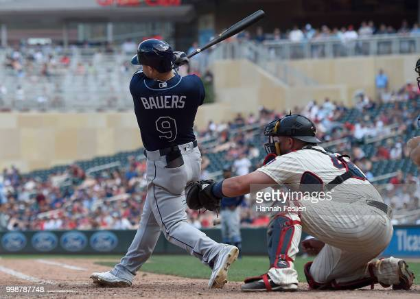Jake Bauers of the Tampa Bay Rays hits a tworun double as Bobby Wilson of the Minnesota Twins catches during the ninth inning of the game on July 14...