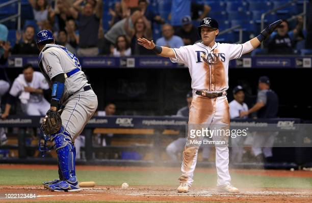 Jake Bauers of the Tampa Bay Rays scores on a walk off force attempt throwing error by Ryan O'Hearn of the Kansas City Royals as Salvador Perez...