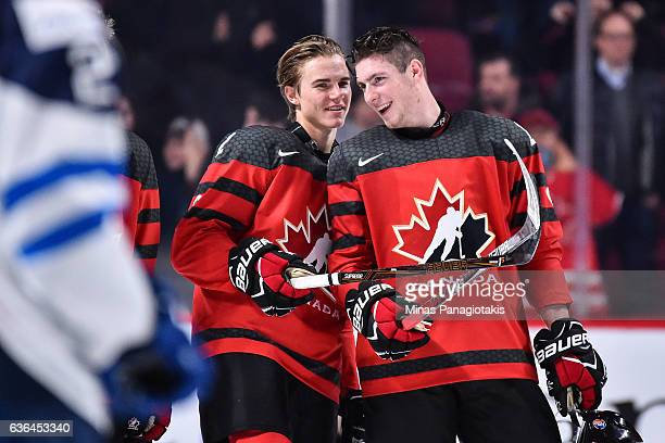 Jake Bean and PierreLuc Dubois of Team Canada chat it up during the IIHF post game exhibition ceremony against Team Finland at the Bell Centre on...