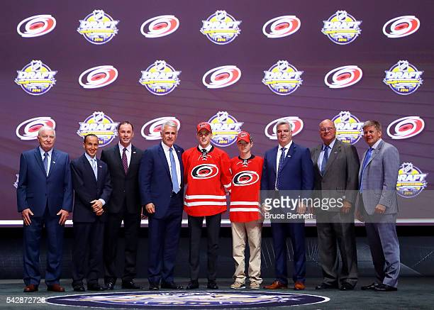 Jake Bean celebrates with the Carolina Hurricanes after being selected 13th during round one of the 2016 NHL Draft on June 24 2016 in Buffalo New York